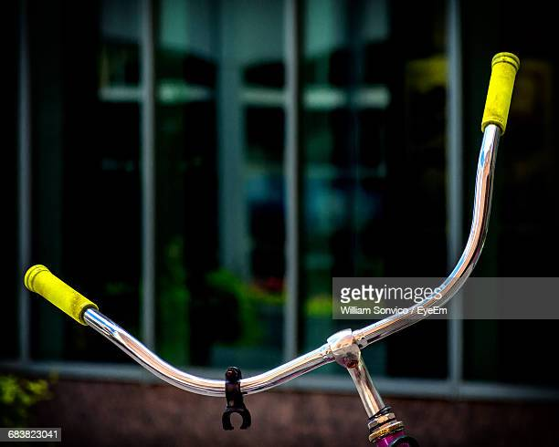 Close-Up Of Bicycle Handle Against Blurred Background