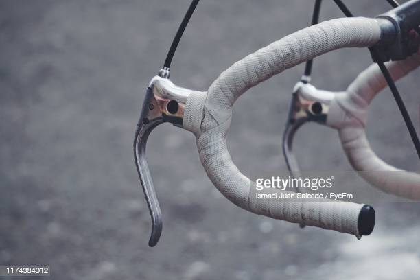 close-up of bicycle handlebar on road - handlebar stock pictures, royalty-free photos & images