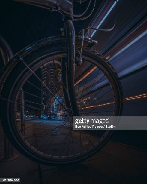 Close-Up Of Bicycle On Footpath At Night
