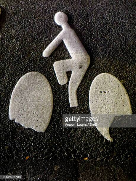 close-up of bicycle roadmark - paris rocks stock pictures, royalty-free photos & images