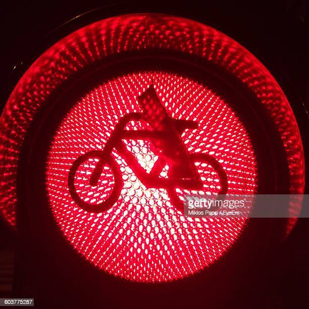 Close-Up Of Bicycle Sign On Red Light