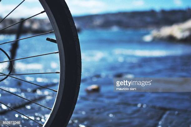 Close-Up Of Bicycle Tire At Beach