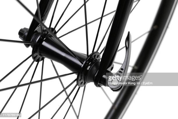 close-up of bicycle wheel against white background - handle stock pictures, royalty-free photos & images