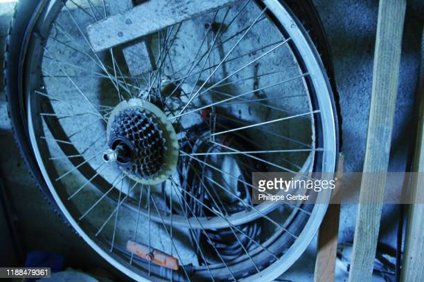 close-up of bicycle wheels in workshop - sarthe stock pictures, royalty-free photos & images