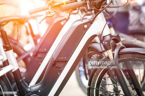 close-up of bicycles in parking lot - bicycle parking station stock photos and pictures