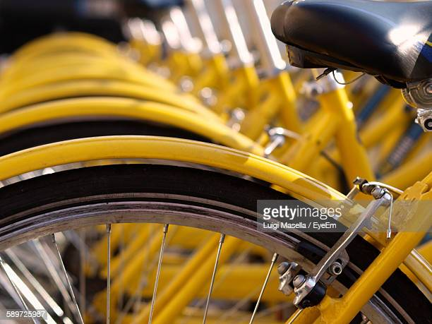 Close-Up Of Bicycles Parked In A Row