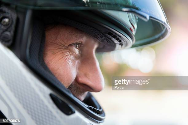 Close-up of biker wearing helmet