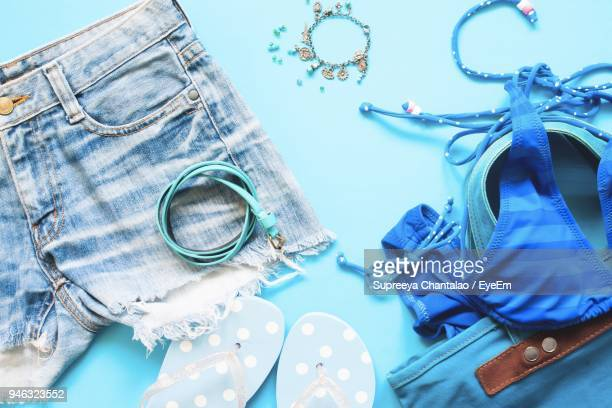 close-up of bikini with purse and hat on yellow background - hot pants stock pictures, royalty-free photos & images