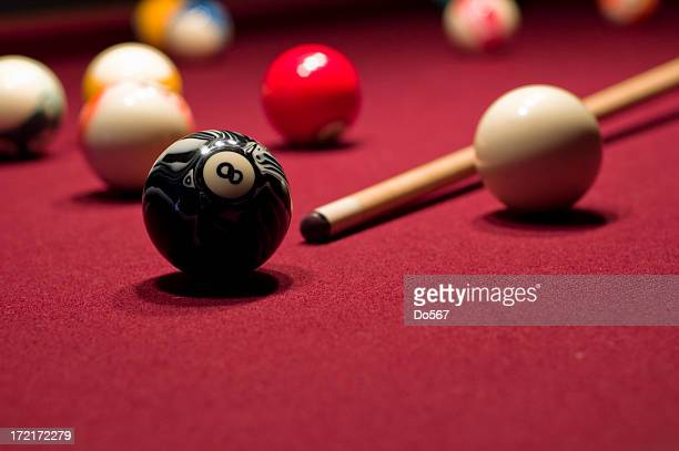 Close-up of billiards cue and eight ball