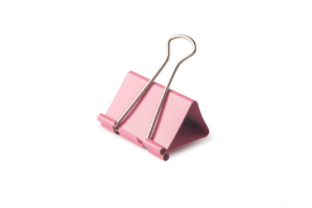 Close-up of binder clip over white background