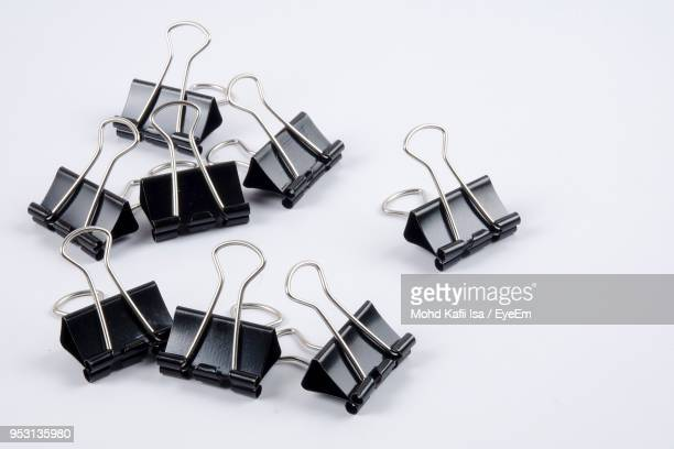 close-up of binder clips on white background - binder clip stock pictures, royalty-free photos & images