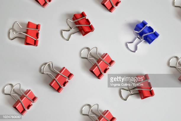 close-up of binder clips over white background - binder clip stock pictures, royalty-free photos & images