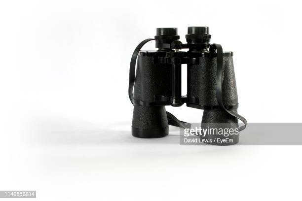 close-up of binocular on white background - binoculars stock pictures, royalty-free photos & images