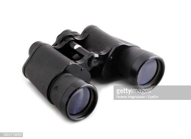 close-up of binoculars over white background - binoculars stock pictures, royalty-free photos & images
