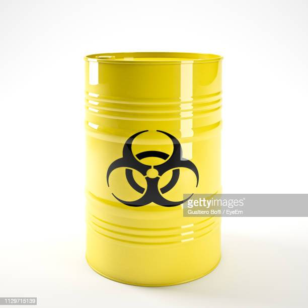 close-up of biohazard symbol on barrel against white background - stahlfass stock-fotos und bilder