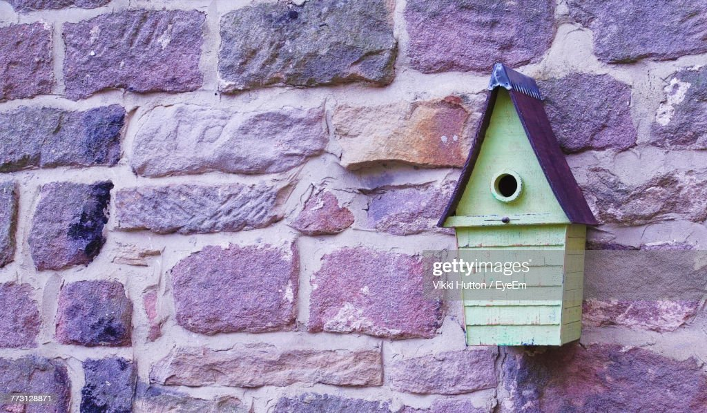 Close-Up Of Birdhouse On Stone Wall : Photo