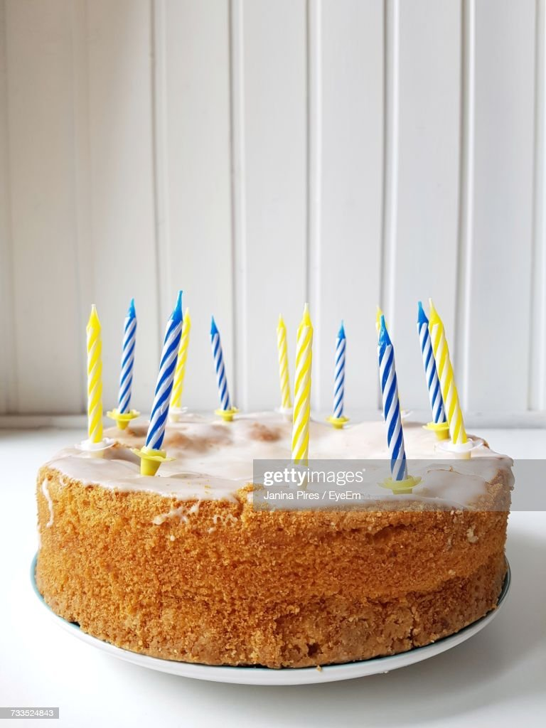 Closeup Of Birthday Cake On Table Against Wall Stock Photo Getty