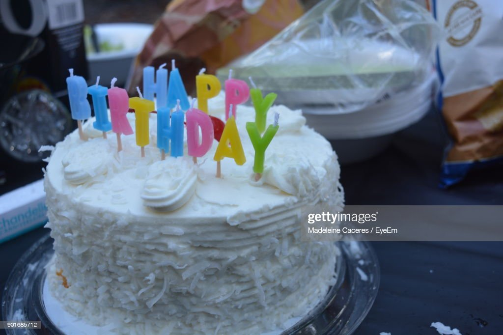 Closeup Of Birthday Cake On Table Stock Photo Getty Images