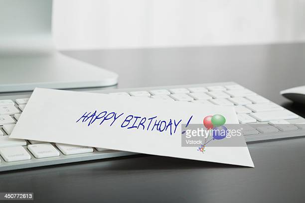 Close-up of birthday card on keyboard