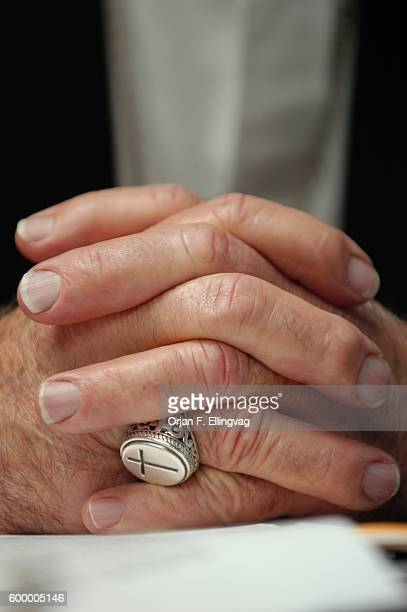 Close-up of Bishop Michael Pfeifer's hands and ring. Pfeifer disagrees strongly with Bush and his allegations that the attempts to remove Saddam...