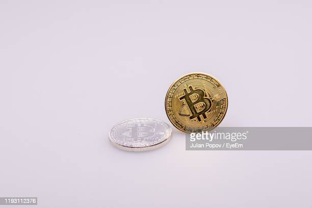 close-up of bitcoins on white background - 仮想通貨 ストックフォトと画像