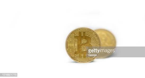 close-up of bitcoins on white background - bitcoin stock-fotos und bilder