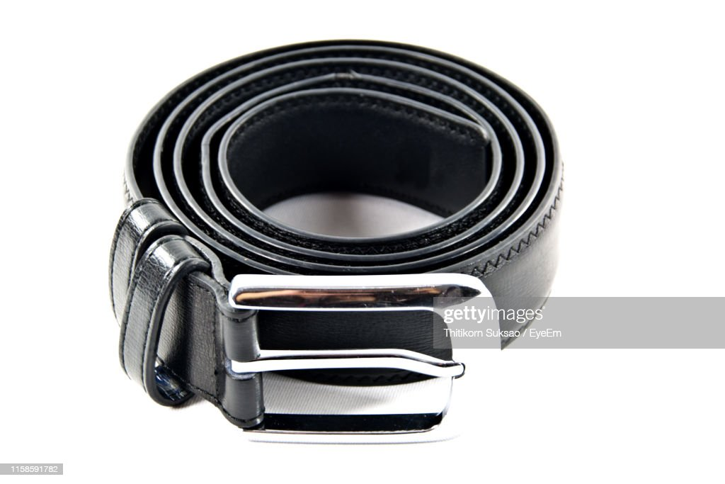 Close-Up Of Black Belt Against White Background : Stock Photo