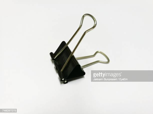 Close-Up Of Black Binder Clip On White Background