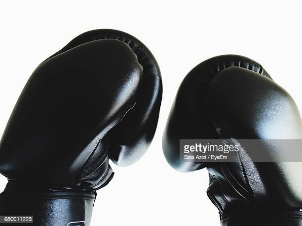 Close-Up Of Black Boxing Gloves Against White Background