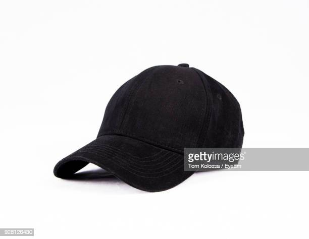 close-up of black cap over white background - hat stock pictures, royalty-free photos & images