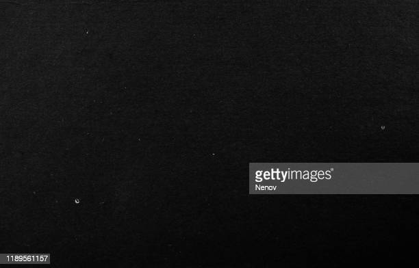 close-up of black cardboard paper texture background - black colour stock pictures, royalty-free photos & images