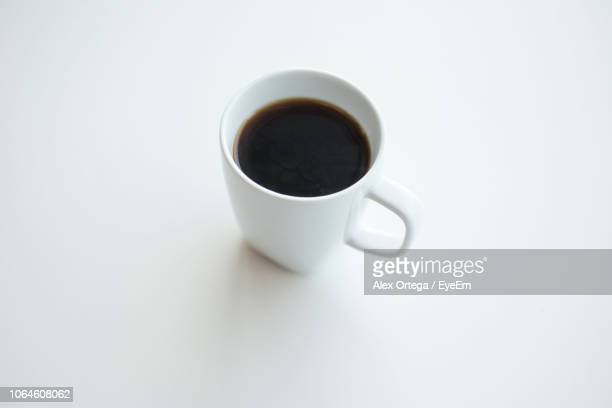 Close-Up Of Black Coffee Cup Over White Background