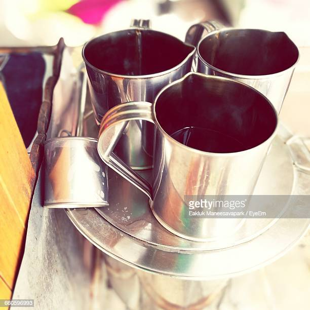 Close-Up Of Black Coffee In Cups On Plate