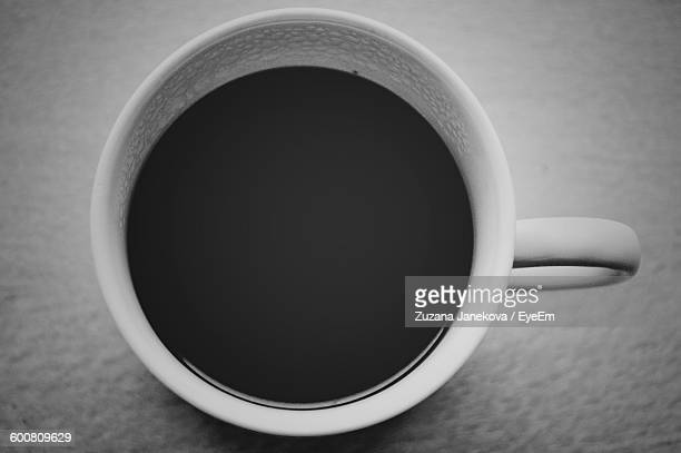 close-up of black coffee on table - zuzana janekova stock pictures, royalty-free photos & images