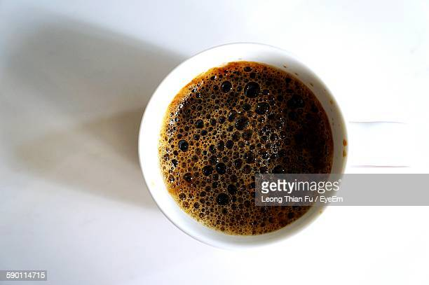 Close-Up Of Black Coffee On White Table