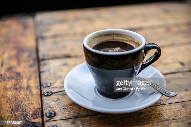 close-up of black coffee on wooden table - black coffee stock pictures, royalty-free photos & images