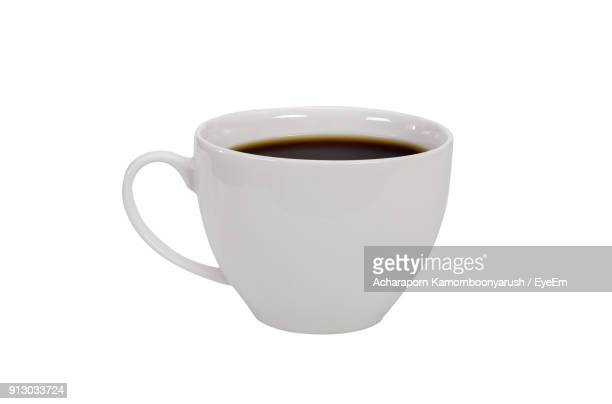 Close-Up Of Black Coffee Over White Background