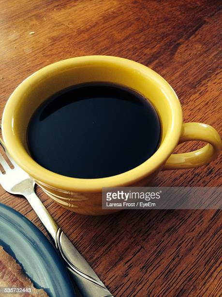 Close-Up Of Black Coffee Served In Cup On Table