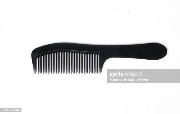 close-up of black comb over white background - hairbrush stock pictures, royalty-free photos & images