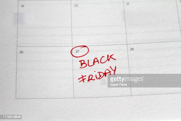 close-up of black friday day written on calendar - black friday stock photos and pictures