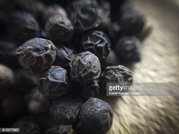 Close-Up Of Black Peppercorns On Table