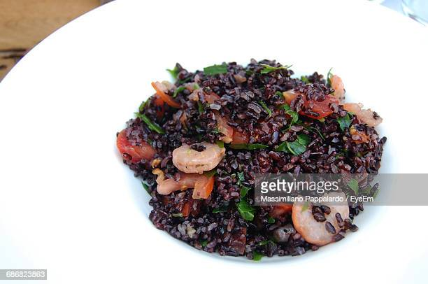 Close-Up Of Black Rice With Prawns In Plate