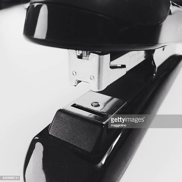Close-Up Of Black Stapler On White Table