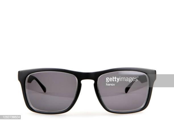 close-up of black sunglasses against white background - サングラス ストックフォトと画像