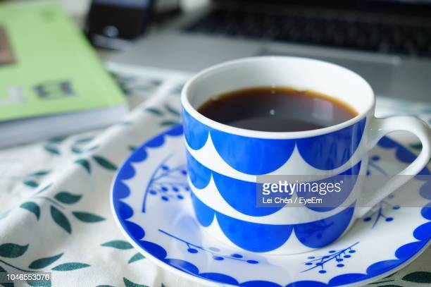 close-up of black tea in cup on table - black tea stock pictures, royalty-free photos & images