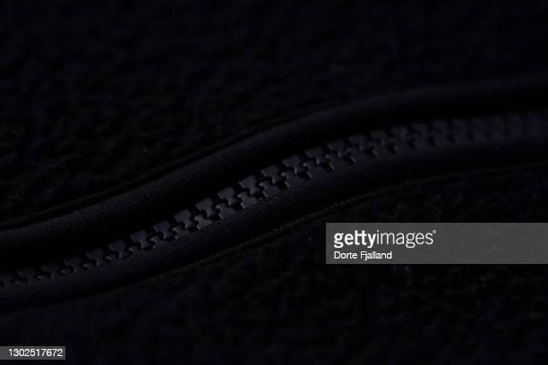 closeup of black zipper on black fabrick - dorte fjalland fotografías e imágenes de stock