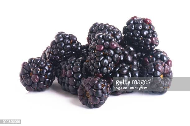 close-up of blackberry against white background - blackberry fruit stock pictures, royalty-free photos & images