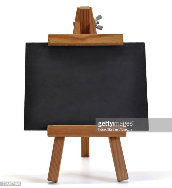 Close-Up Of Blackboard Against White Background