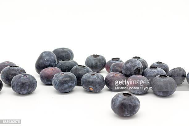 Close-Up Of Blackcurrants Against White Background