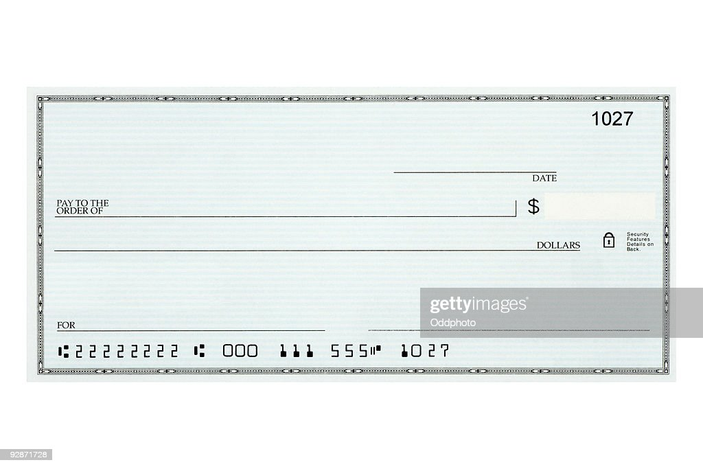Close Up Of Blank Bank Check Sample Against White Background Stock Photo